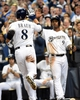 Mar 31, 2014; Milwaukee, WI, USA;   Milwaukee Brewers left fielder Ryan Braun (8) and shortstop Jean Segura (9) celebrate after scoring on third baseman Aramis Ramirez (not pictured) double in the fourth inning against the Atlanta Braves of an opening day baseball game at Miller Park. Mandatory Credit: Benny Sieu-USA TODAY Sports
