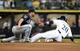 Mar 31, 2014; Milwaukee, WI, USA;   Milwaukee Brewers catcher Jonathan Lucroy (20) steals 2nd base as the ball gets away from Atlanta Braves second baseman Dan Uggla (26) in the 6th inning of an opening day baseball game at Miller Park. Mandatory Credit: Benny Sieu-USA TODAY Sports
