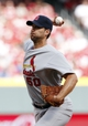 Mar 31, 2014; Cincinnati, OH, USA; St. Louis Cardinals starting pitcher Adam Wainwright (50) pitches during the second inning against the Cincinnati Reds at Great American Ball Park. Mandatory Credit: Frank Victores-USA TODAY Sports