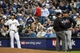 Mar 31, 2014; Milwaukee, WI, USA;   Atlanta Braves manager Fredi Gonz  lez challenged a call by first base umpire Greg Gibson that Milwaukee Brewers left fielder Ryan Braun (8) was safe in the sixth inning of an opening day baseball game at Miller Park. The call was reversed and Braun was called out after umpires reviewed instant replay.  Mandatory Credit: Benny Sieu-USA TODAY Sports