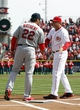 Mar 31, 2014; Cincinnati, OH, USA; Cincinnati Reds manager Bryan Price (38) and St. Louis Cardinals manager Mike Matheny (22) shake hands at the plate prior to the game at Great American Ball Park. Mandatory Credit: Frank Victores-USA TODAY Sports
