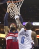 Mar 31, 2014; Charlotte, NC, USA; Charlotte Bobcats center Bismack Biyombo (0) blocks the shot of Washington Wizards forward Drew Gooden (90) during the first half at Time Warner Cable Arena. Mandatory Credit: Jeremy Brevard-USA TODAY Sports