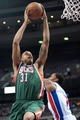 Mar 31, 2014; Auburn Hills, MI, USA; Milwaukee Bucks center John Henson (31) shoots the ball during the third quarter against the Detroit Pistons at The Palace of Auburn Hills. Pistons won 116-111. Mandatory Credit: Tim Fuller-USA TODAY Sports