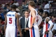 Mar 31, 2014; Auburn Hills, MI, USA; Detroit Pistons head coach John Loyer talks with guard Kentavious Caldwell-Pope (5) forward Jonas Jerebko (33) and guard Will Bynum (R) during the fourth quarter against the Milwaukee Bucks at The Palace of Auburn Hills. Pistons won 116-111. Mandatory Credit: Tim Fuller-USA TODAY Sports