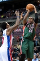 Mar 31, 2014; Auburn Hills, MI, USA; Detroit Pistons guard Brandon Jennings (7) defends Milwaukee Bucks forward Khris Middleton (22) during the fourth quarter at The Palace of Auburn Hills. Pistons won 116-111. Mandatory Credit: Tim Fuller-USA TODAY Sports