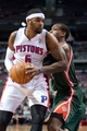 Mar 31, 2014; Auburn Hills, MI, USA; Milwaukee Bucks forward Khris Middleton (22) guards Detroit Pistons forward Josh Smith (6) during the first quarter at The Palace of Auburn Hills. Mandatory Credit: Tim Fuller-USA TODAY Sports