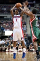 Mar 31, 2014; Auburn Hills, MI, USA; Detroit Pistons guard Brandon Jennings (7) shoots the ball over Milwaukee Bucks guard Brandon Knight (11) during the second quarter at The Palace of Auburn Hills. Mandatory Credit: Tim Fuller-USA TODAY Sports