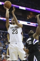 Mar 31, 2014; New Orleans, LA, USA; New Orleans Pelicans forward Anthony Davis (23) goes up for a basket beside Sacramento Kings forward Reggie Evans (30) in the second half against the New Orleans Pelicans at the Smoothie King Center. Sacramento defeated New Orleans 102-97. Mandatory Credit: Crystal LoGiudice-USA TODAY Sports
