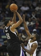 Mar 31, 2014; New Orleans, LA, USA; Sacramento Kings forward Rudy Gay (8) is defended by New Orleans Pelicans forward Darius Miller (2) as he goes up for a basket in the second half at the Smoothie King Center. Sacramento defeated New Orleans 102-97. Mandatory Credit: Crystal LoGiudice-USA TODAY Sports