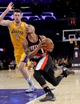 Apr 1, 2014; Los Angeles, CA, USA; Los Angeles Lakers forward Ryan Kelly (4) guards Portland Trail Blazers guard Damian Lillard (0) during the first half of the game at Staples Center. Mandatory Credit: Jayne Kamin-Oncea-USA TODAY Sports