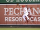 Apr 1, 2014; Anaheim, CA, USA; Los Angeles Angels right fielder Kole Calhoun (56) is unable to catch a run-scoring double fly ball by Seattle Mariners left fielder Dustin Ackley (not pictured) at Angel Stadium of Anaheim. Mandatory Credit: Kirby Lee-USA TODAY Sports