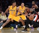Apr 1, 2014; Los Angeles, CA, USA;  Los Angeles Lakers forward Nick Young (0) guards Portland Trail Blazers guard Mo Williams (25) during the second half of the game at Staples Center. Trail Blazers won 124-112. Mandatory Credit: Jayne Kamin-Oncea-USA TODAY Sports