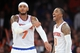 Apr 2, 2014; New York, NY, USA; New York Knicks guard J.R. Smith (8) and forward Carmelo Anthony (7) look on against the Brooklyn Nets during the second half at Madison Square Garden. The New York Knicks won 110-81. Mandatory Credit: Joe Camporeale-USA TODAY Sports