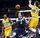 Apr 2, 2014; Denver, CO, USA; New Orleans Pelicans forward Luke Babbitt (8) has the ball swatted away by Denver Nuggets forward Jan Vesely (24) during the first half at Pepsi Center. Mandatory Credit: Chris Humphreys-USA TODAY Sports