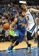 Apr 2, 2014; Minneapolis, MN, USA;  Minnesota Timberwolves guard Ricky Rubio (9) drives along the baseline past Memphis Grizzlies forward James Johnson (3) in the fourth quarter at Target Center. The Wolves defeated the Grizzlies 102-88.  Mandatory Credit: Marilyn Indahl-USA TODAY Sports