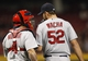 Apr 2, 2014; Cincinnati, OH, USA; St. Louis Cardinals catcher Yadier Molina (4) goes to the mound during the first inning to talk to starting pitcher Michael Wacha (52) in the game against the Cincinnati Reds at Great American Ball Park. Mandatory Credit: Frank Victores-USA TODAY Sports