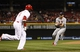 Apr 2, 2014; Cincinnati, OH, USA; Cincinnati Reds second baseman Brandon Phillips (4) is thrown out during the first inning by the St. Louis Cardinals starting pitcher Michael Wacha (52) at Great American Ball Park. Mandatory Credit: Frank Victores-USA TODAY Sports
