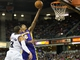 Apr 2, 2014; Sacramento, CA, USA; Los Angeles Lakers guard Kent Bazemore (6) goes up for a layup against Sacramento Kings guard Ray McCallum (3) during the second quarter at Sleep Train Arena. Mandatory Credit: Kelley L Cox-USA TODAY Sports