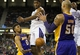 Apr 2, 2014; Sacramento, CA, USA; Los Angeles Lakers forward Nick Young (0) passes the ball to center Robert Sacre (50) against Sacramento Kings forward Jason Thompson (34) during the second quarter at Sleep Train Arena. Mandatory Credit: Kelley L Cox-USA TODAY Sports