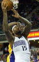 Apr 2, 2014; Sacramento, CA, USA; Los Angeles Lakers forward Jordan Hill (27) fouls Sacramento Kings center DeMarcus Cousins (15) on a shot during the fourth quarter at Sleep Train Arena. The Sacramento Kings defeated the Los Angeles Lakers 107-102. Mandatory Credit: Kelley L Cox-USA TODAY Sports
