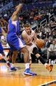 Apr 2, 2014; Phoenix, AZ, USA; Phoenix Suns guard Goran Dragic (1) dribbles around Los Angeles Clippers Jordan during the third quarter at US Airways Center. The Clippers won 112-108. Mandatory Credit: Casey Sapio-USA TODAY Sports
