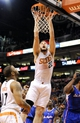 Apr 2, 2014; Phoenix, AZ, USA; Phoenix Suns center Miles Plumlee (22) dunks the ball against the Los Angeles Clippers during the third quarter at US Airways Center. The Clippers won 112-108. Mandatory Credit: Casey Sapio-USA TODAY Sports