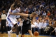 Apr 3, 2014; Oklahoma City, OK, USA; San Antonio Spurs guard Tony Parker (9) drives to the basket against Oklahoma City Thunder center Kendrick Perkins (5) during the third quarter at Chesapeake Energy Arena. Mandatory Credit: Mark D. Smith-USA TODAY Sports