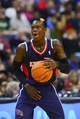 Mar 29, 2014; Washington, DC, USA; Atlanta Hawks guard Dennis Schroder (17) dribbles up the court during the fourth quarter against the Washington Wizards  at Verizon Center. Washington Wizards defeated Atlanta Hawks 101-97. Mandatory Credit: Tommy Gilligan-USA TODAY Sports