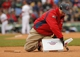 Apr 4, 2014; Boston, MA, USA; A Fenway Park grounds crew member replaces third base during a break in the action between the Milwaukee Brewers and Boston Red Sox. Mandatory Credit: David Butler II-USA TODAY Sports