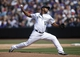 Apr 4, 2014; Denver, CO, USA; Colorado Rockies pitcher Juan Nicasio (12) delivers a pitch during the second inning against the Arizona Diamondbacks at Coors Field. Mandatory Credit: Chris Humphreys-USA TODAY Sports
