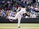 Apr 4, 2014; Denver, CO, USA; Colorado Rockies third baseman Nolan Arenado (28) fields a ground ball during the fourth inning against the Arizona Diamondbacks at Coors Field. Mandatory Credit: Chris Humphreys-USA TODAY Sports