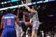 Apr 4, 2014; Brooklyn, NY, USA; Detroit Pistons guard Peyton Siva (34) attempts a pass in the air amidst Brooklyn Nets defenders during the first half at Barclays Center. Mandatory Credit: Joe Camporeale-USA TODAY Sports