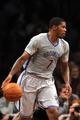 Apr 4, 2014; Brooklyn, NY, USA; Brooklyn Nets guard Joe Johnson (7) dribbles against the Detroit Pistons during the first half at Barclays Center. Mandatory Credit: Joe Camporeale-USA TODAY Sports