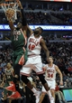 Apr 4, 2014; Chicago, IL, USA;  Milwaukee Bucks forward Jeff Adrien (12) dunks the ball as he is defended by Chicago Bulls center Nazr Mohammed (48) during the second quarter at the United Center. Mandatory Credit: David Banks-USA TODAY Sports