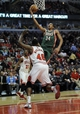 Apr 4, 2014; Chicago, IL, USA;  Milwaukee Bucks guard Giannis Antetokounmpo (34) goes to the basket against the Chicago Bulls center Nazr Mohammed (48) during the second quarter at the United Center. Mandatory Credit: David Banks-USA TODAY Sports