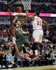 Apr 4, 2014; Chicago, IL, USA; Chicago Bulls guard Jimmy Butler (21) blocks the shot of Milwaukee Bucks guard Brandon Knight (11) during the first quarter at the United Center. Mandatory Credit: David Banks-USA TODAY Sports