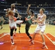 Apr 4, 2014; Chicago, IL, USA; Milwaukee Bucks forward Jeff Adrien (12) tries to get the ball from Chicago Bulls forward Carlos Boozer (5) as forward Mike Dunleavy (34) is nearby at the United Center. Mandatory Credit: David Banks-USA TODAY Sports
