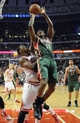 Apr 4, 2014; Chicago, IL, USA; Milwaukee Bucks guard Brandon Knight (11) shoots over Chicago Bulls guard Jimmy Butler (21) during the first quarter at the United Center. Mandatory Credit: David Banks-USA TODAY Sports