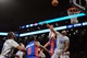 Apr 4, 2014; Brooklyn, NY, USA; Brooklyn Nets center Jason Collins (98) blocks a shot by Detroit Pistons forward Jonas Jerebko (33) during the first half at Barclays Center. The Nets won 116-104. Mandatory Credit: Joe Camporeale-USA TODAY Sports