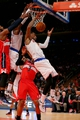 Apr 4, 2014; New York, NY, USA; New York Knicks shooting guard J.R. Smith (8) jumps for a rebound against Washington Wizards shooting guard Bradley Beal (3) during the fourth quarter of a game at Madison Square Garden. The Wizards defeated the Knicks 90-89. Mandatory Credit: Brad Penner-USA TODAY Sports