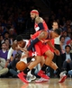 Apr 4, 2014; New York, NY, USA; New York Knicks shooting guard Iman Shumpert (21) and Washington Wizards shooting guard Bradley Beal (3) and power forward Drew Gooden (90) scramble for a loose ball during the fourth quarter of a game at Madison Square Garden. The Wizards defeated the Knicks 90-89. Mandatory Credit: Brad Penner-USA TODAY Sports