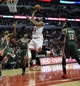 Apr 4, 2014; Chicago, IL, USA;  Chicago Bulls guard Jimmy Butler (21) shoots against the Milwaukee Bucks during the second half at the United Center. The Chicago Bulls defeated the Milwaukee Bucks 102-90. Mandatory Credit: David Banks-USA TODAY Sports