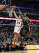 Apr 4, 2014; Chicago, IL, USA;  Chicago Bulls forward Mike Dunleavy (34) goes to the basket and is defended by Milwaukee Bucks guard Brandon Knight (11) during the second half at the United Center. The Chicago Bulls defeated the Milwaukee Bucks 102-90. Mandatory Credit: David Banks-USA TODAY Sports