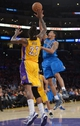 Apr 4, 2014; Los Angeles, CA, USA; Dallas Mavericks guard Devin Harris (20) is defended by Los Angeles Lakers forward Jordan Hill (27) defends at Staples Center. Mandatory Credit: Kirby Lee-USA TODAY Sports