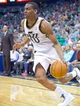 Apr 4, 2014; Salt Lake City, UT, USA; Utah Jazz guard Alec Burks (10) dribbles along the baseline during the second half against the New Orleans Pelicans at EnergySolutions Arena. The Jazz won 100-96. Mandatory Credit: Russ Isabella-USA TODAY Sports