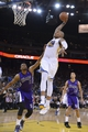 April 4, 2014; Oakland, CA, USA; Golden State Warriors forward Marreese Speights (5) dunks the ball against Sacramento Kings forward Rudy Gay (8) during the third quarter at Oracle Arena. The Warriors defeated the Kings 102-69. Mandatory Credit: Kyle Terada-USA TODAY Sports