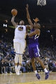 April 4, 2014; Oakland, CA, USA; Golden State Warriors forward Marreese Speights (5) shoots against Sacramento Kings forward Travis Outlaw (25) during the fourth quarter at Oracle Arena. The Warriors defeated the Kings 102-69. Mandatory Credit: Kyle Terada-USA TODAY Sports