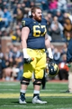 Apr 5, 2014; Ann Arbor, MI, USA; Michigan Wolverines offensive linesman Kyle Kalis (67) walks on the filed during the Spring Game at Michigan Stadium. Mandatory Credit: Tim Fuller-USA TODAY Sports