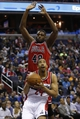 Apr 5, 2014; Washington, DC, USA; Washington Wizards guard Andre Miller (24) prepares to shoot the ball as Chicago Bulls center Nazr Mohammed (48) defends in the second quarter at Verizon Center. Mandatory Credit: Geoff Burke-USA TODAY Sports