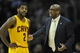 Apr 5, 2014; Cleveland, OH, USA; Cleveland Cavaliers head coach Mike Brown talks to guard Kyrie Irving (2) in the first quarter against the Charlotte Bobcats at Quicken Loans Arena. Mandatory Credit: David Richard-USA TODAY Sports
